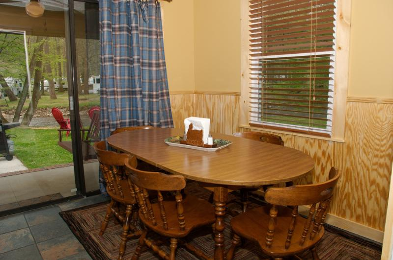 Dining Area with Seating for Six.  Kitchen includes dishes and cooking needed for six people.