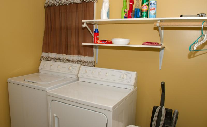 Laundry Room off Kitchen With Vaccum & Cleaning Supplies