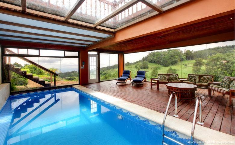 atrium with heated swimming pool and spa, and steam room