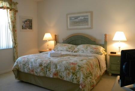 Master bedroom with kingsize bed.