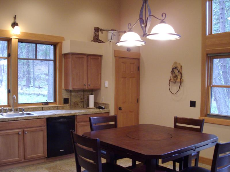 Dining Room to Kitchen area, lots of windows