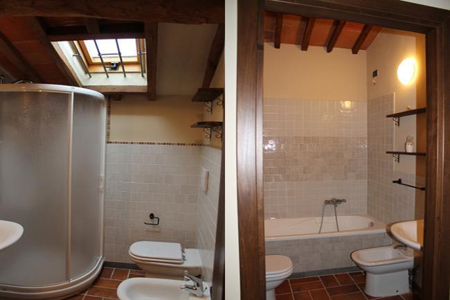 The two bathrooms, with shower and tub, in sleeping area