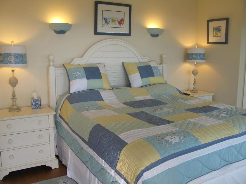 master bed 2  with deck stunning beach views en suite large king bed