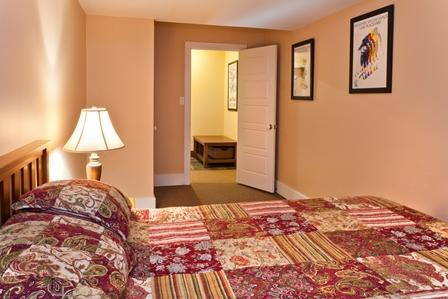 Tranquil downstairs bedroom with a comfortable queen bed and bedding