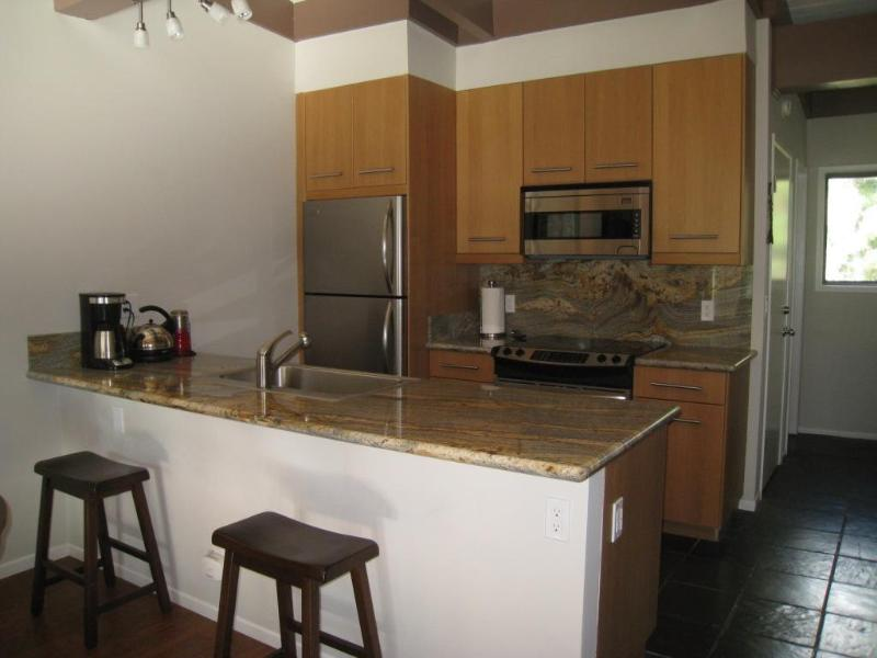 Kitchen with granite counters & stainless appliances