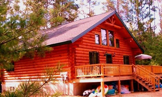 Unique Handmade Log Cabin: Unplug and Feel The Peace Sleeps 11, Many Amenities, vacation rental in Alma Center