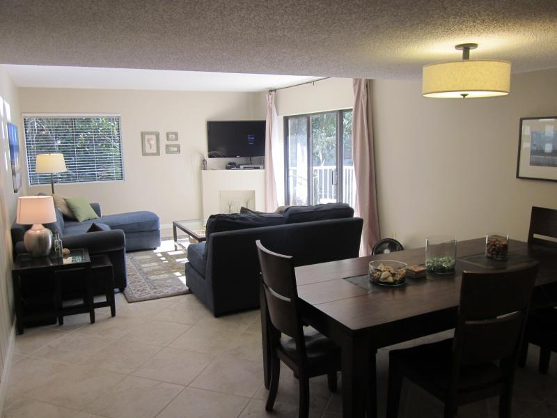 Open concept dinning area with seating for 6-8, perfect for family and friends.