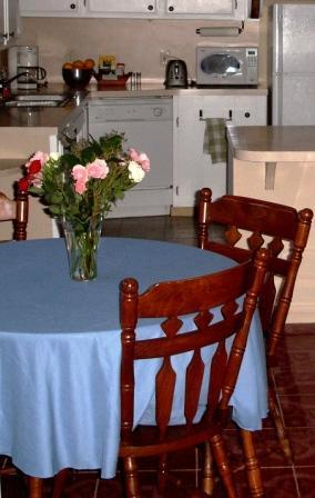 Fully-equipped kitchen, dining area includes table with extra leaves