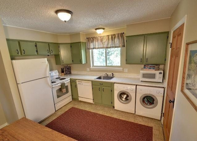 Fully stocked kitchen with front-loading washer and dryer
