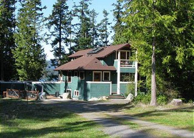 Coho Lane House is at the end of a private drive. Spacious deck is at the left & can be accessed from house or front yard.
