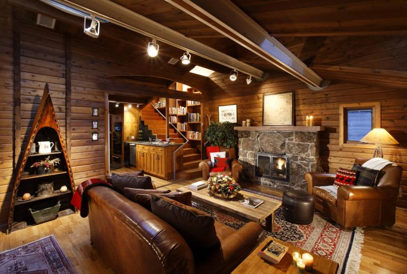 Rustic stone fireplace and hickory walls