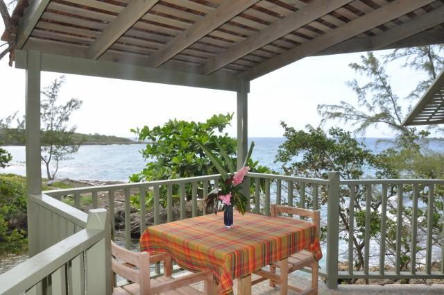 private deck dining over private beach