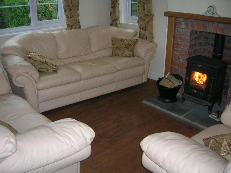 Lounge with 3 seater sofa, 2 seater sofa and 1 armchair, wood burner and 32' flat screen TV