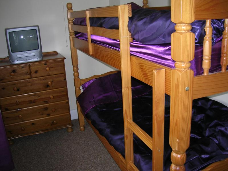 3rd bedroom containing Adult sized bunks a TV for videos and a selection of children's videos.