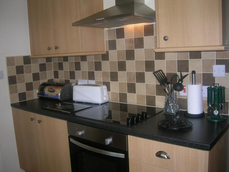 Kitchen with Electric cooker, Toaster and fresh bread awaiting your arrival!