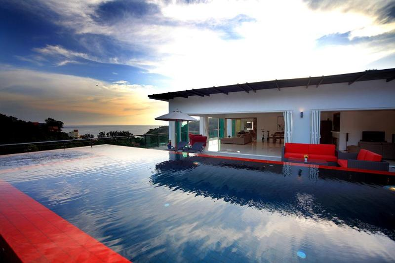 The pool, part of the Villa In The Sky, and the ocean. As seen from the far edge of the pool