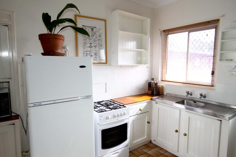 cosy country kitchen is fully equipped at Monet's Retro Maylands accommodation