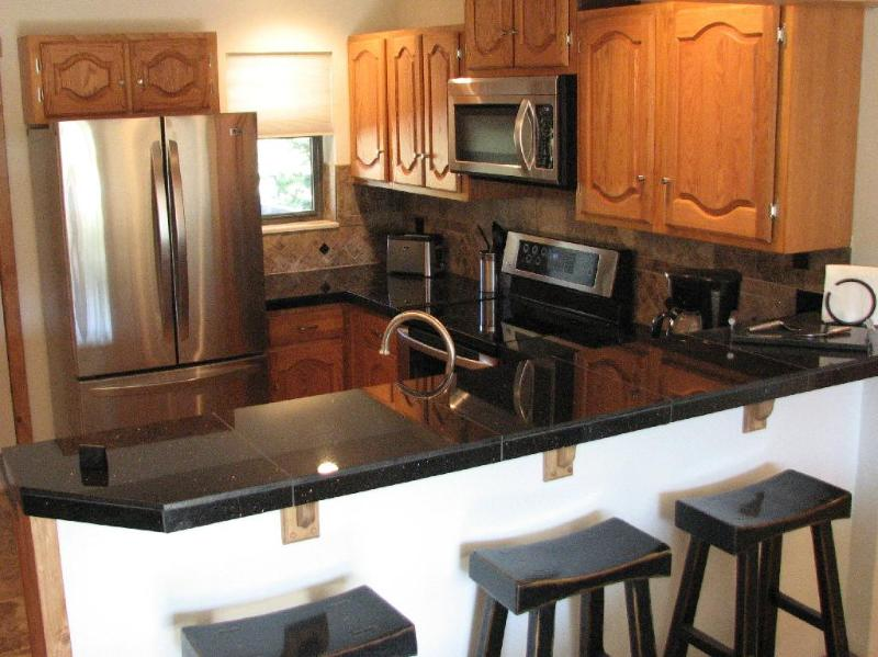 Kitchen w/ Stainless Steel Appliances