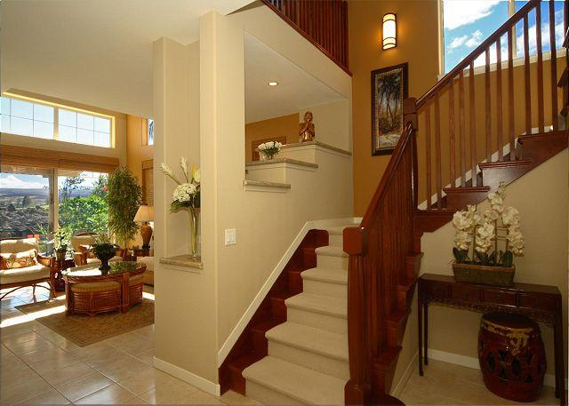 Staircase to upper level with two bedrooms