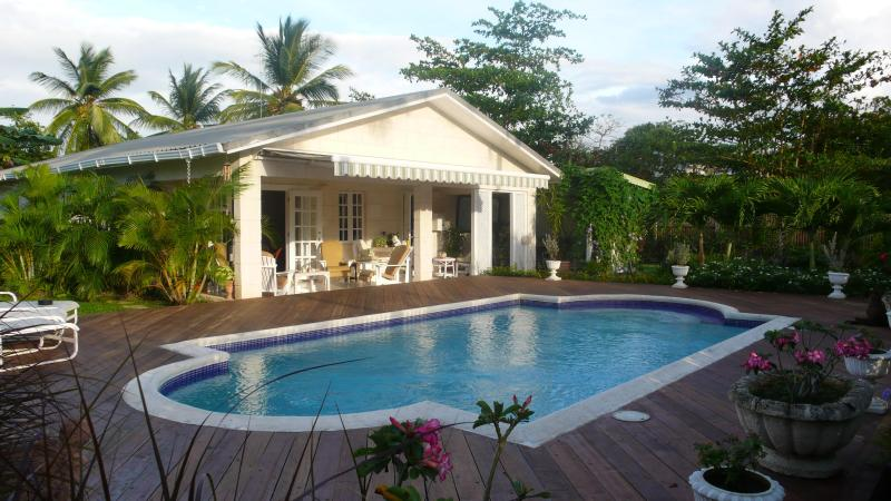 Villa, pool in a private garden with great location next to Holetown. Just two minute walk to beach.