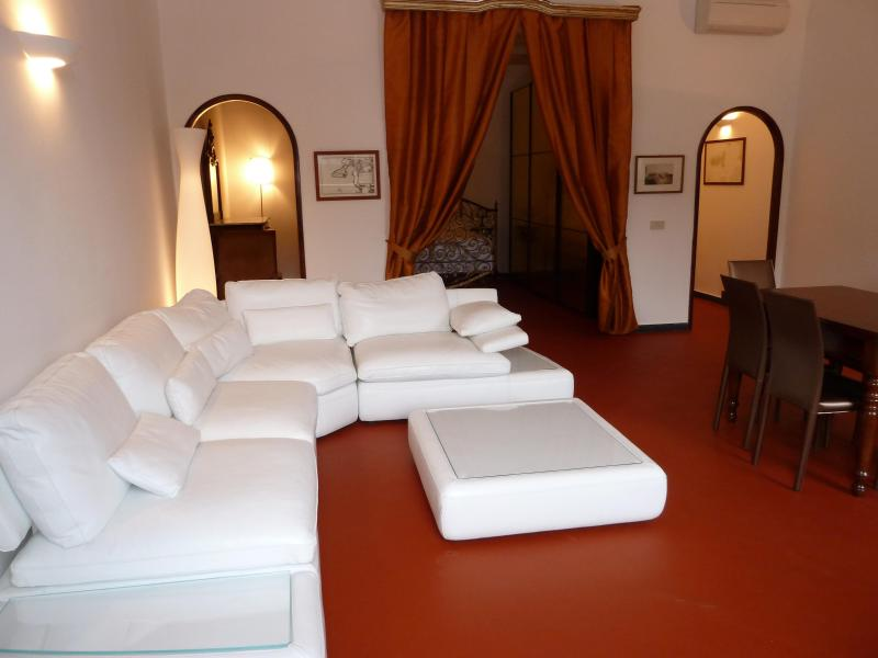 1st floor - The huge white leather sofa in the living room, with the alcove behind