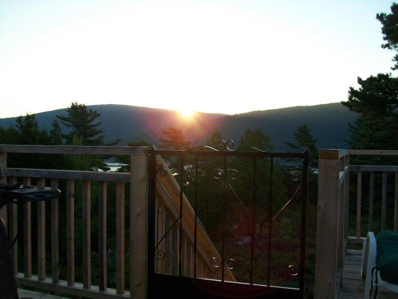 View of Sunrise over the mountains of Acadia National Park and Somes Sound from upper deck