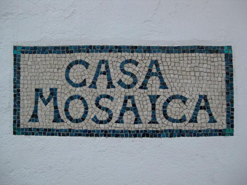Casa Mosaica sign in the street.