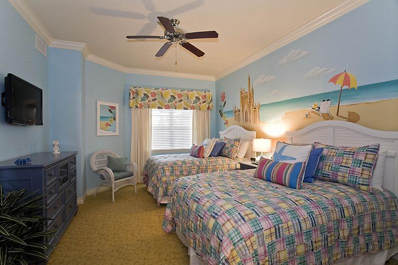 Mickey beach theme bedroom, for the young and young at heart. 2 full size beds, LCD TV & ensuite