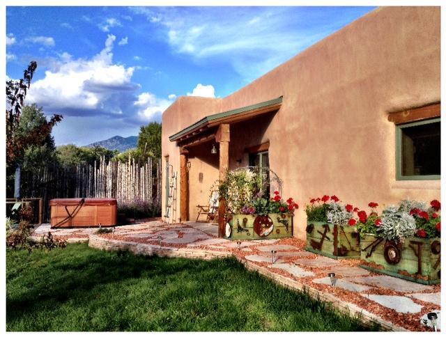 Backyard, hot tub and peek of Taos Mountain