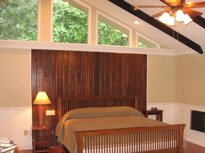 Upstairs master bedroom with king bed and ensuite bathroom