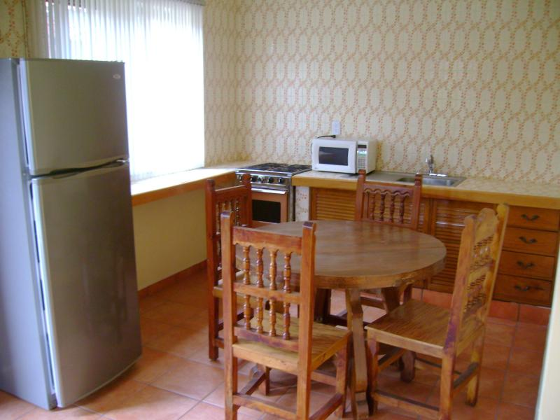 Small dining/full equipped kitchens in three Bungalows