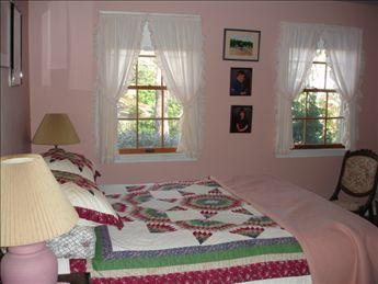 First floor bedroom with queen bed