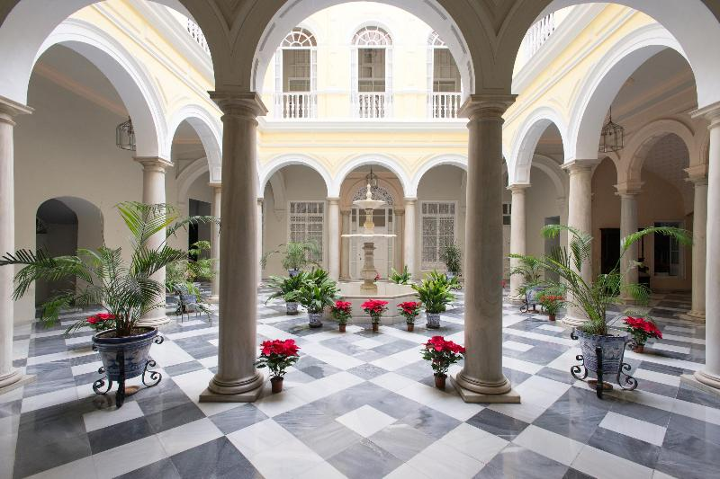 Central courtyard of the palace with marble floor and columns