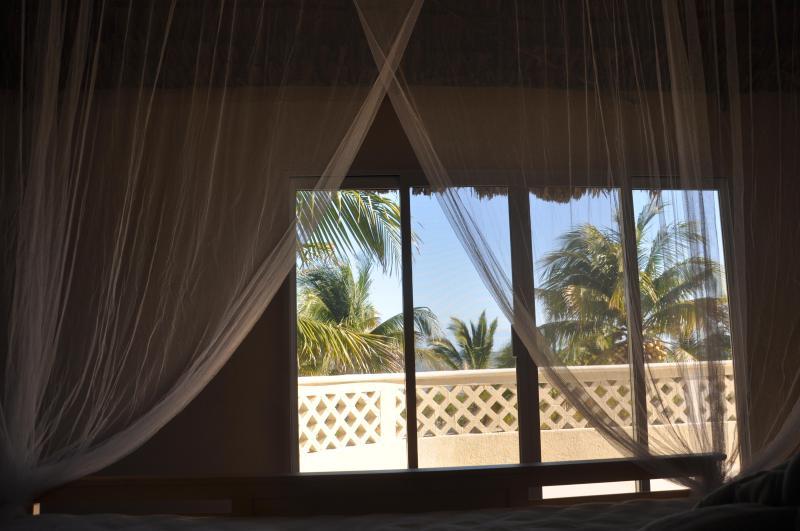 Bedroom Suite  #2 upstairs with thatch roof facing ocean