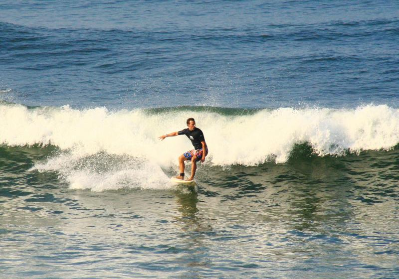 Surfing at Redgate Beach