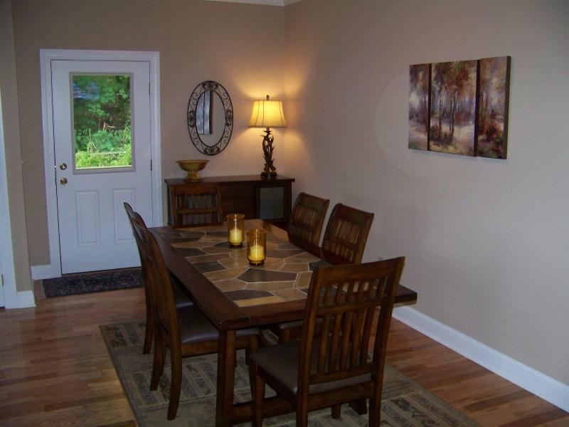 Dining table & Sideboard.  Door to outside grill & picnic table