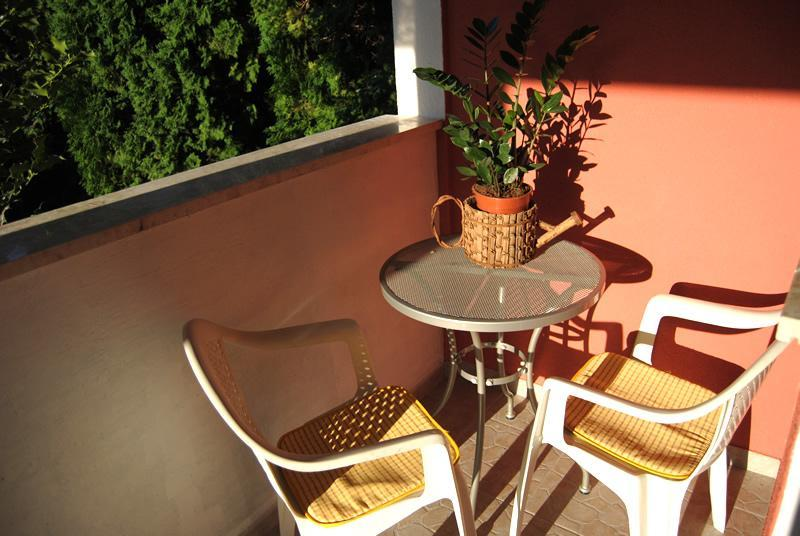 The little balcony in front of the entrance. Meditation area for morning coffee and a cigarette:)