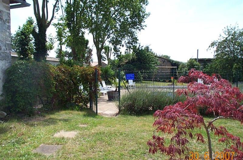 The swimming pool, with security fence and alarm