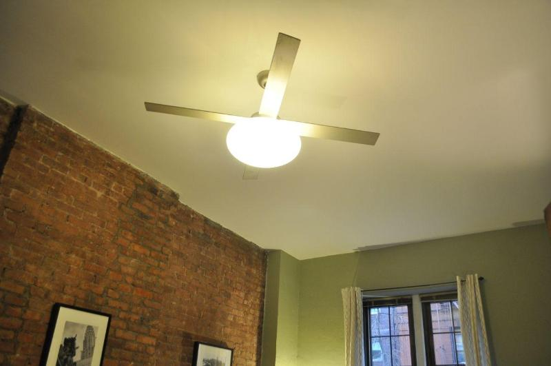 Ceiling fan for good air circulation (there is also an air-conditioner unit). Lots of light!