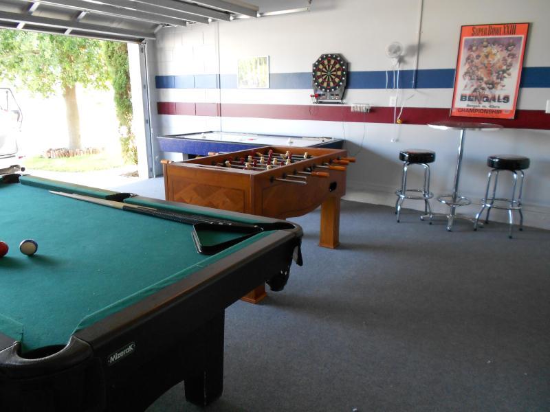 Game Room w/ fooseball, pool table, air hockey, darts