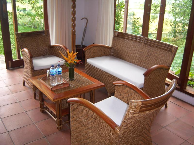 Teak and Rattan seating arrangement  in Mezzanine Suite