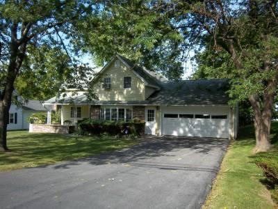 Village street side with large driveway and garage