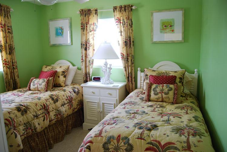 Second bedroom has two twin beds.