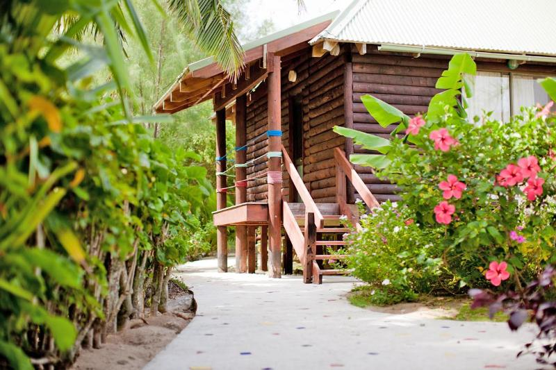 Just down the pathway, your very own private villa awaits you.