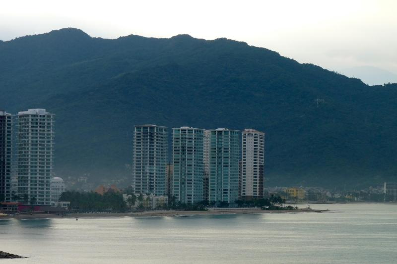 The grand towers of Peninsula Vallarta stand out gloriously from across the bay.
