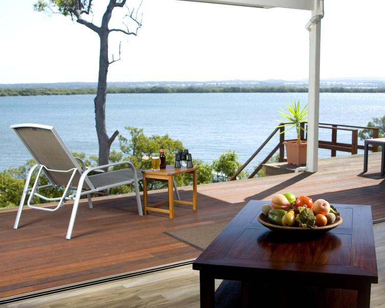 Push back the 14m of glass sliding doors, allowing the waters of Moreton Bay in