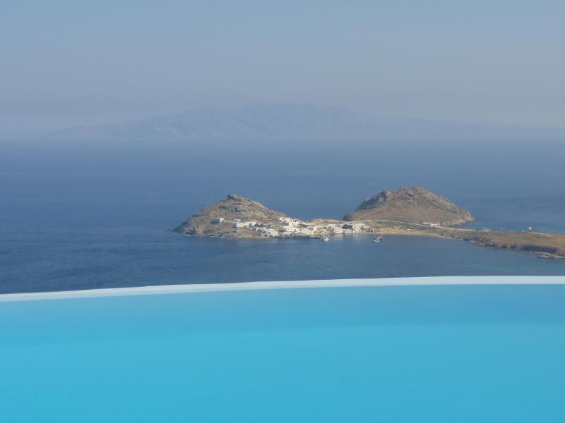 Infinity pool floating over the Aegean