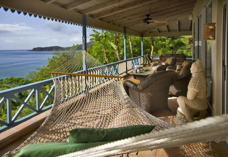 The commanding deck and stunning views from the Sunset Watch Upper Level Villa patio.