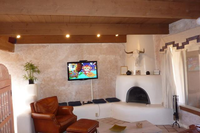 Living Room with large screen Digital TV and Kiva fireplace