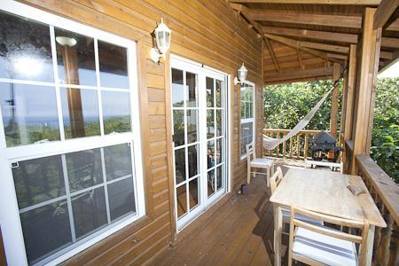 Upper sunset deck accessed via double french doors from Living Room